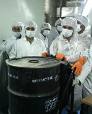 Technicians handle a container of uranium ore concentrate at Iran's Isfahan uranium conversion facility in 2005. Senate Republicans are discussing whether to attach a controversial Iran sanctions proposal to a pending Ukraine aid bill.