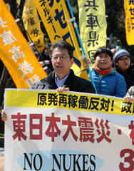 Japanese anti-nuclear demonstrators in Kobe hold a protest against government plans to resume atomic-energy production, as the country marks the third anniversary of the reactor meltdown at Fukushima. Some Japanese politicians reportedly want to see the country's nuclear reactors restarted and producing plutonium again because of the deterrence signal they feel it would send.