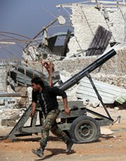 A Syrian rebel fighter fires a mortar towards pro-regime forces in a clash on the outskirts of Aleppo last week. U.S. Secretary of State John Kerry on Thursday said it remained unclear how an international standoff over Ukraine might affect efforts to remove chemical arms from Syria.