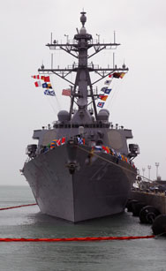 The USS Donald Cook docks in the southern port of Rota in February as the first of four U.S. missile interceptor-equipped warships sent to Spain to form a key part of NATO's ballistic-missile shield. The Pentagon's schedule for achieving some antimissile capabilities in Europe may be overly optimistic, a new congressional report finds.