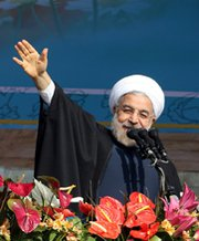 Iranian President Hassan Rouhani waves at a rally in Tehran last month. Eighty-two senators in a Tuesday letter said Congress and the Obama administration must begin preparing for negotiations with Iran to end, with or without a long-term deal to address the nation's disputed nuclear activities.