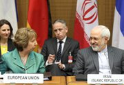 Iranian Foreign Minister Mohammad Javad Zarif, right, and European Union foreign policy chief Catherine Ashton attend the first day of a multilateral nuclear meeting in Vienna on Tuesday. It remains unclear how an international standoff over the disputed Crimean Peninsula may affect efforts to resolve tensions over Iran's nuclear program.