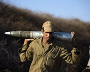 An Israeli soldier carries a shell during an August 2013 military exercise near the border with Syria, in the Israeli-annexed Golan Heights. Israel could be the next nation to ratify the Comprehensive Nuclear Test Ban Treaty, a key leader on the accord said.