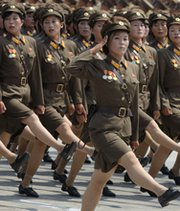 North Korean soldiers march through Kim Il Sung Square in Pyongyang during a military parade last July. The pattern of excavation work at North Korea's nuclear-testing grounds could point to a plan to conduct more frequent underground atomic explosions, according to one new expert theory.