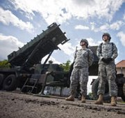U.S. soldiers stand by a Patriot missile-defense battery in May 2010 at an army base in the northern Polish town of Morag. Poland on Thursday announced it would speed the selection of a vendor to provide the country with a domestic antimissile capability amid heightened concerns about Russian aggression.