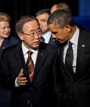 U.N. Secretary General Ban Ki-moon chats with U.S. President Obama after a group photo at the 2014 Nuclear Security Summit on Tuesday in The Hague, Netherlands. The U.N. head warned that the nuclear nonproliferation regime could be undermined by recent events in Ukraine.