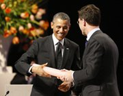 Dutch Prime Minister Mark Rutte hands over a symbolic stick to President Obama during the closing session of the Nuclear Security Summit in The Hague on Tuesday. Thirty-five countries committed to bolstering nuclear security, backing a global drive spearheaded by Obama to prevent dangerous materials falling into the hands of terrorists.