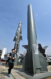 A boy runs past a replica of North Korean Scud-B missile at the Korean War Memorial in Seoul on Wednesday, the same day that Pyongyang test-fired two medium-range ballistic missiles.