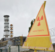 A warning sign seen in 2013 outside Ukraine's defunct Chernobyl nuclear power plant. Ukraine's top diplomat on Tuesday said his country might request international assistance to help secure its nuclear sites.