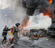Firefighters seek to contain flames from an apparent January suicide bombing in a Hezbollah stronghold in Beirut, Lebanon. U.S. legislators are considering a potential push to impose new sanctions on Iran for supporting Hezbollah.