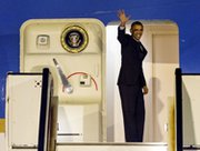 President Obama waves as he walks up the stairs of Air Force One before leaving Amsterdam, Netherlands, on March 25. The leader attended a two-day Nuclear Security Summit in The Hague.