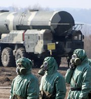 Russian military personnel stand near fueling equipment during a 2010 drill at a missile-forces research institute south of Moscow. Russia on Thursday launched a three-day nuclear war drill it said was scheduled last year.