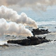 South Korean marine amphibious assault vehicles arrive on the seashore during a joint landing exercise by U.S. and South Korean forces on Monday in Pohang. The two Koreas on Monday exchanged live fire across a disputed maritime border a day after Pyongyang warned it could carry out a new kind of nuclear test.