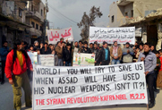 Syrian anti-government protesters rally on Feb. 15 at Kafr Nabil. The head of the U.N. nuclear agency on Monday said he had not heard from rebels reported to have taken control of an area once believed to house a Syrian nuclear reactor site (AP Photo/Edlib News Network).