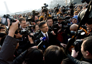 U.S. Ambassador to China Gary Locke faces a horde of journalists on Tuesday while entering the Great Hall of the People in Beijing. China and the United States have come to terms on new U.N. Security Council sanctions to be enacted in response to North Korea's Feb. 12 nuclear test (AP Photo/Andy Wong).