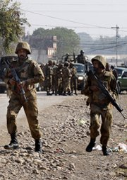 Pakistani soldiers prepare for a December 2012 operation against Taliban fighters near Peshawar. Pakistani officials say the Western media focus on militant attacks against military installations overstates the potential for terrorists to seize  a nuclear weapon from the nation's arsenal (AP Photo/Mohammad Sajjad).