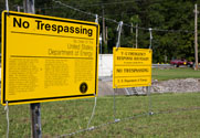 Warning signs at the Y-12 National Security Complex in Tennessee. Members of the House Energy and Commerce Committee on Wednesday reaffirmed their position that more oversight of the U.S. nuclear weapons complex is needed (AP Photo/Erik Schelzig).