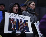 A woman protests against Russian military intervention in the Crimea region of Ukraine on Sunday in New York City.