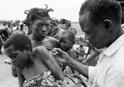 A health worker vaccinates a child against smallpox, circa 1962, in what is now the Democratic Republic of the Congo. A U.S. scientist is advising against destroying the world's final known stocks of smallpox, which was eradicated from nature in the 1970s.