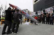 South Koreans lift up a fake North Korean missile during an April 15 protest in Seoul. The U.S. Defense Department on Thursday said Pyongyang was advancing toward its stated goal of having a nuclear-armed ICBM capable of reaching the United States (AP Photo/Kin Cheung).