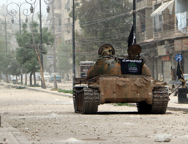 A tank belonging to the rebels' Islamic Front is pictured in the middle of a street during reported clashes with government forces in the Hanano district of the northern Syrian city of Aleppo in April. A rebel offensive near Damascus last week encroached on the country's last chemical weapons stocks.