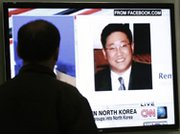 "A television in Seoul displays a photograph of tour operator Kenneth Bae, who received a 15-year prison sentence in North Korea last week for committing ""hostile acts"" against the state. Pyongyang on Sunday said it had no plans to invite a U.S. dignitary to negotiate Bae's release (AP Photo/Ahn Young-joon)."
