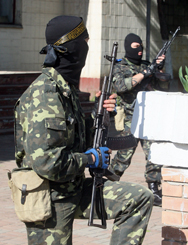"Armed pro-Russian militants on Tuesday take position in the eastern Ukrainian city of Donetsk. Kiev authorities on Monday announced they had detained a group of individuals for allegedly attempting to smuggle possible ""dirty bomb"" material into the southeastern part of the country."