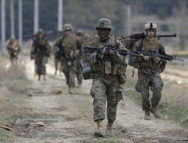 U.S. Marines march south of Seoul last month as part of military exercises staged with South Korea. A senior Defense Department official on Tuesday said the Pentagon's ability to keep forces ready for possible Korean Peninsula hostilities might be harmed by any long-term budget reduction mandates (AP Photo/Lee Jin-man).