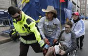 One victim of the Boston Marathon bombing is moved away from the finish line on April 15. A House panel on Thursday held the first congressional hearing on security failures leading up to the attack that killed three people (AP Photo/Charles Krupa).