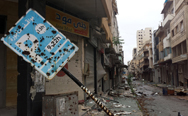 A bullet-riddled parking sign stands amid debris in a deserted street leading into the old city of Homs on Thursday. Heavy fighting has stalled efforts to secure Syria's remaining stocks of warfare chemicals, located outside Damascus, a key U.N. official said.