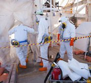 Specially trained workers prepare last month to enter the tunnels of the Waste Isolation Pilot Plant in New Mexico, where they are working to identify the cause of a radiation leak. It could be up to three years before the nuclear repository resumes full operations, a senior official said on Thursday.