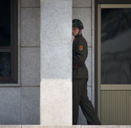 A North Korean soldier walks along his side of the truce village of Panmunjom in the demilitarized zone on Wednesday. Despite fears to the contrary, Pyongyang does not appear to be preparing an imminent nuclear test, a U.S. think tank said on Tuesday.