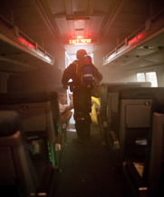 A participant in a Marine Corps-led biodefense drill moves through an Amtrak train in New York City in 2012. Congressional investigators said the Defense Department is not following its own policy to regularly reconsider its list of top biological-weapon threats.