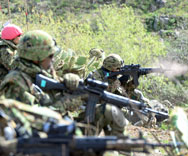 Japanese Self-Defense Forces soldiers fire live ammunition during a joint exercise with U.S. troops at Camp Pendleton in southern California, in February. Japanese Prime Minister Shinzo Abe on Thursday voiced a desire for the country's pacifist constitution to be amended to expand the number of situations where the use of military force is permitted.