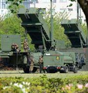 Japanese soldiers ready to refuel Patriot Advanced Capability 3 missile launchers deployed at the defense ministry in Tokyo in April. The United States reportedly has proposed establishing a joint intelligence-sharing framework with South Korea and Japan.