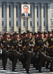 North Korean soldiers march during a military parade in Pyongyang in April 2012. Recent satellite images suggest that the Kim Jong Un regime has sped up the pace of work on a number of construction projects at its main missile launch complex.