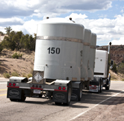 A truck transports transuranic nuclear waste from Los Alamos National Laboratory to the Waste Isolation Pilot Plant in New Mexico in 2011. The state on Tuesday ordered actions at the underground storage facility to permanently seal off containers potentially at risk of rupturing.