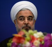 "Iranian President Hassan Rouhani attends a Thursday press conference in Shanghai, where he said Tehran can ""likely"" resolve a nuclear standoff with other countries by July."