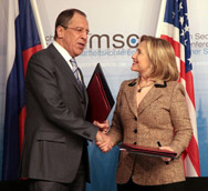 Then-U.S. Secretary of State Hillary Clinton and Russian Foreign Minister Sergei Lavrov shake hands in February 2011 following the entry into force of the bilateral New START pact. The U.S. House of Representatives on Thursday voted to provisionally block funding for implementation of the accord.