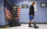 U.S. military veteran and amputee Lloyd Epps walks after doctors serviced his prosthetic leg at a Veterans Administration facility in New York in January. A bill that the House approved on Thursday would cut some controversial nuclear weapons spending in a bid to help veterans.