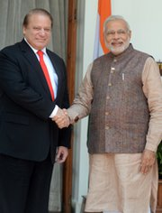 India's newly sworn-in Prime Minister Narendra Modi, right, shakes hands with Pakistani Prime Minister Nawaz Sharif during a meeting in New Delhi on Tuesday. The two men discussed issues related to terrorism and prospects for enhancing bilateral ties.