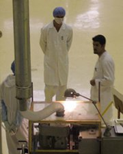 Personnel work at Iran's Isfahan uranium conversion facility in 2009. Tehran appears to be completing a system at the plant for converting low-enriched uranium gas into solid oxide, the U.N. nuclear watchdog indicated last week.
