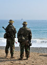 South Korean marines stand on a beach in March during a joint exercise with U.S. troops in Pohang. Seoul on Tuesday rebuffed a call by U.S. lawmakers to deepen ballistic missile defense cooperation with the United States and Japan.