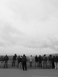 Spectators gather in December 2010 near Vandenberg Air Force Base, Calif., to watch an ultimately unsuccessful test of the Ground-based Midcourse Defense system's ability to intercept a ballistic missile target. Another intercept test of the system is planned for June.