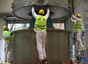 Workers prepare highly enriched uranium for removal from a Hungarian research reactor site in 2013. Political obstacles may stand in the way of any new multilateral effort to curb civilian uses of highly enriched uranium, according to a new analysis.