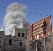 Smoke rises from a reported April government strike in Aleppo, Syria. Legislation passed on Friday by the U.S. House of Representatives would require intelligence officials to supply Congress with details on any chemical-warfare materials Syria's government may be trying to conceal.