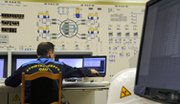 An employee looks at computer screens in the fourth reactor of the Kalinin Nuclear Power Plant in Udomlya, Russia, some 200 miles outside Moscow, in March 2011. Experts fear that atomic facilities could become targets of cyber-attacks, with potentially devastating consequences.