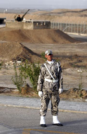 An Iranian Revolutionary Guard soldiers stands in front of the Natanz uranium enrichment plant in 2007. Israeli officials have reportedly cited 240 kilograms of higher-enriched uranium, enough for one nuclear weapon, as the red line that Iran must not cross (AP Photo/Hasan Sarbakhshian).