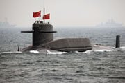 A nuclear-powered Chinese submarine, shown in 2009. China could be able within two years to field nuclear-tipped ballistic missiles on its submarines, according to a draft U.S. report (AP Photo/Guang Niu).