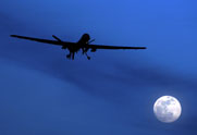 A U.S. Predator drone is shown flying over Afghanistan in January 2010. The Pentagon confirmed this week that an Iranian fighter jet fired on a Predator on Nov. 1 (AP Photo/Kirsty Wigglesworth).